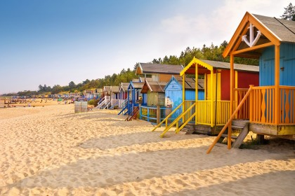 Visit the colourful beach huts at Wells next the Sea